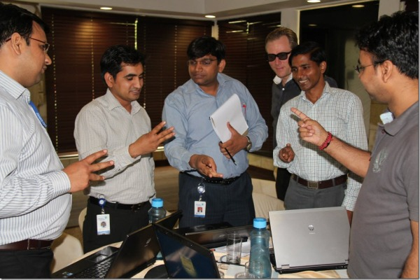 "One of the teams estimating tasks using the ""fist"" estimation method"